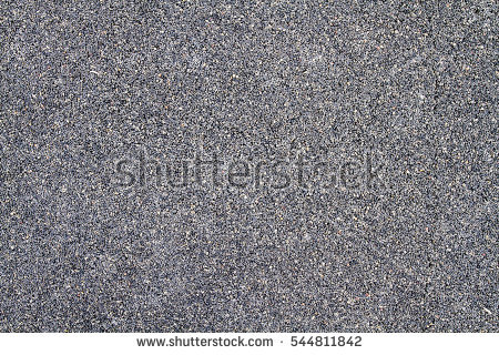 a_smooth_dark_grey_asphalt_pavement_texture_with_small_rocks
