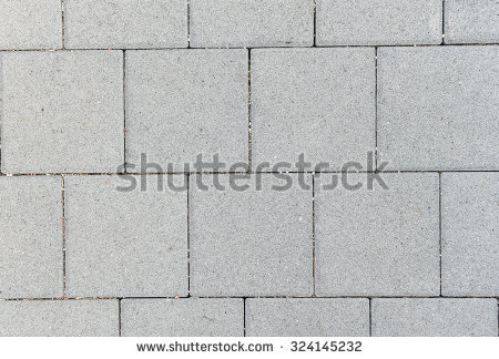concrete_or_cobble_gray_square_pavement_slabs_or_stones_for_floor_wall_or_path_traditional_fence_court_backyard_or_road_paving