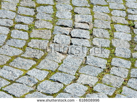 texture_background_the_pavement_of_granite_stone_paved_roadway_street_any_paved_area_or_surface_old_cobblestone_road_pavement_texture_grass_between_stones