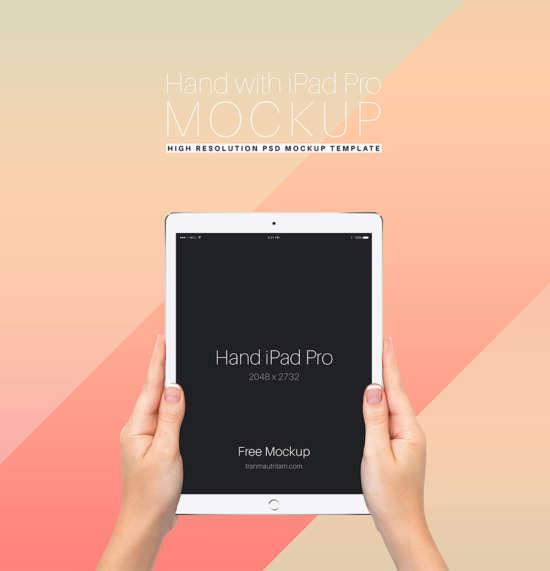 hand_holding_ipad_pro_free_psd_mockup_template