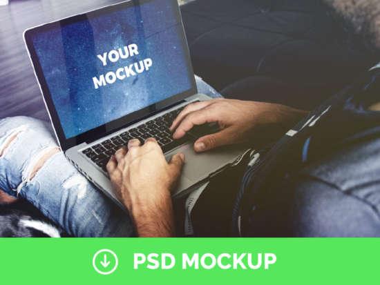 man_holding_macbook_pro_free_psd_mockup