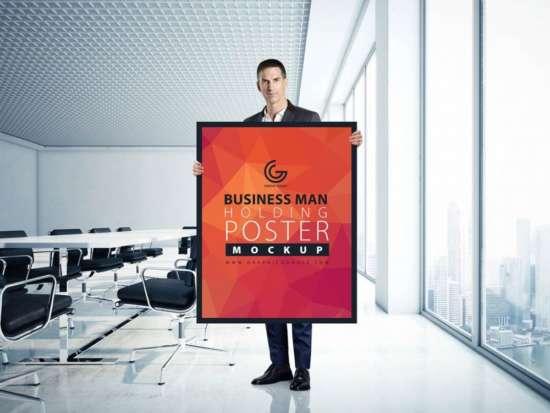 businessman_holding_poster_mockup