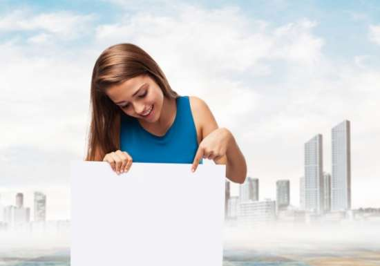woman_holding_a_poster_with_a_town_background