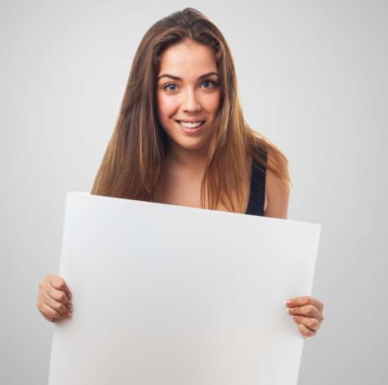 woman_smiling_with_a_poster