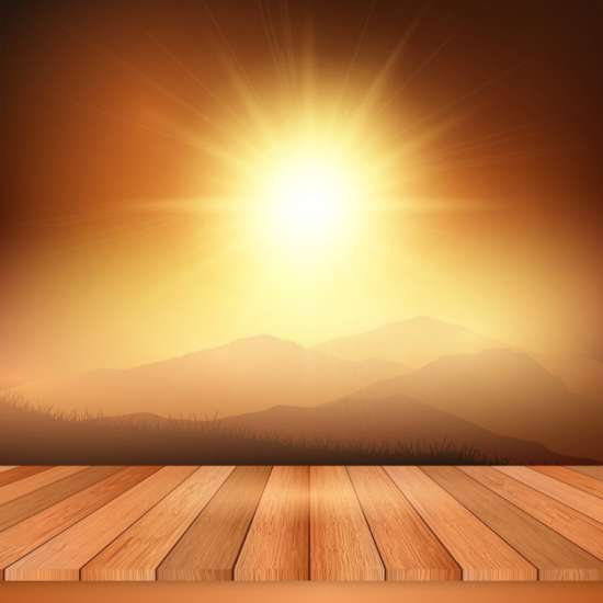 wooden_table_looking_out_to_a_view_of_a_sunny_landscape