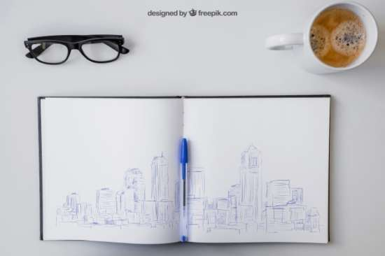 open_notebook_with_pen_drawing,_glasses_and_coffee