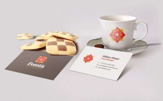 free_business_card_and_coffee_cup_scene_mockup_psd