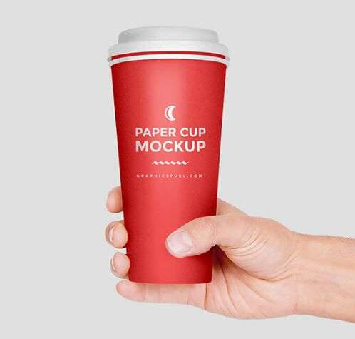paper_cup_in_hand_mockup_psd